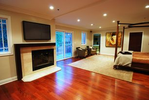 Contemporary Master Bedroom with insert fireplace, six panel door, Standard height, Casement, French doors, can lights