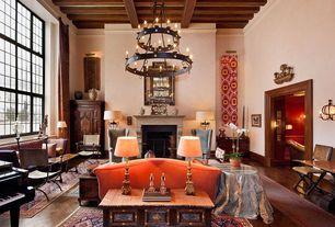 Eclectic Living Room with High ceiling, wood frame door, Hardwood floors, Laura Sofa, Camino two-tier chandelier