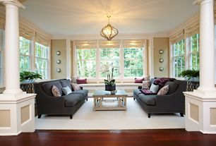 Contemporary Living Room with double-hung window, Standard height, Crown molding, Columns, Sunken living room, Window seat