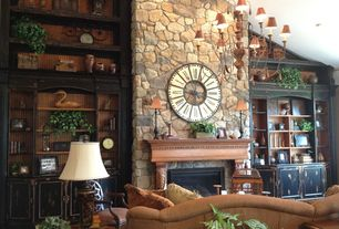 Country Living Room with stone fireplace, High ceiling, Carpet, Built-in bookshelf, Chandelier