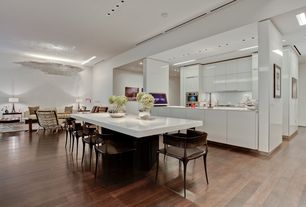 Contemporary Great Room with White lacquer finish, Hardwood floors, Corian- Designer White, Open wall galley kitchen
