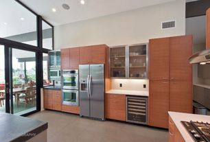 Contemporary Kitchen with Concrete counters, picture window, Built In Refrigerator, Kitchen island, built-in microwave, Flush