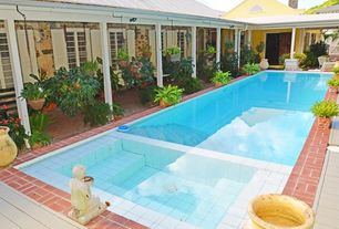 Traditional Swimming Pool with Casement, Raised beds, exterior brick floors, Other Pool Type, French doors