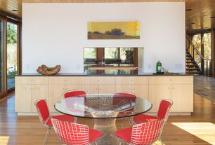 Contemporary Dining Room with Destiny: slab cabinets, Laminate floors, Bertoia Side Chair with Full Cover
