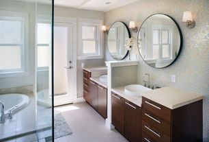 Contemporary Master Bathroom with drop in bathtub, Concrete tile , Wall sconce, double-hung window, Wall Tiles, Bathtub