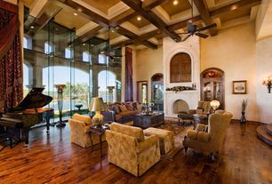 Traditional Great Room with Cement fireplace, High ceiling, Wall sconce, Ceiling fan, Hardwood floors, Faux finish paint