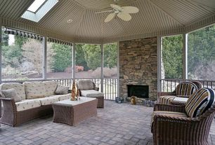 Traditional Porch with outdoor pizza oven, Screened porch, picture window, exterior stone floors, Fence, Skylight