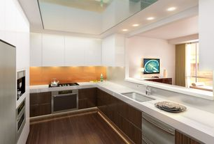 Contemporary Kitchen with Standard height, double wall oven, Open wall, Galley, Bamboo floors, Bamboo cabinet doors, Flush