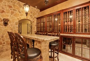 Mediterranean Wine Cellar with Vintage cellars - trilogy wine cellar credenza, specialty door, Built-in bookshelf, Paint