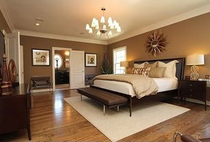 Contemporary Master Bedroom with Chandelier, Laminate floors, Regina andrew vintage leather tufted gallery bench