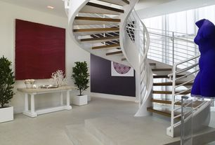 Modern Staircase with Hardwood floors, High ceiling, Spiral staircase, Finished concrete floors