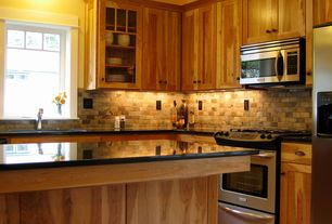 Craftsman Kitchen with Ge over the range microwave oven, Kitchen island, Stone Tile, L-shaped, Simple granite counters