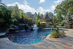 Traditional Swimming Pool with Raised beds, picture window, exterior stone floors, French doors, Other Pool Type, Fountain
