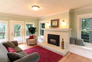 Traditional Living Room with Window seats, Crown moulding, Safavieh California Red Area Shag Rug, Painted stone fireplace