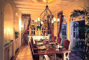 Eclectic Dining Room with French doors, terracotta tile floors, Chandelier, High ceiling, Arched window, Exposed beam