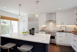 Contemporary Kitchen with Pendant light, Laminate floors, interior brick