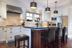 Contemporary Kitchen with Crown molding, Flat panel cabinets, Kitchen island, Simple marble counters, Concrete counters