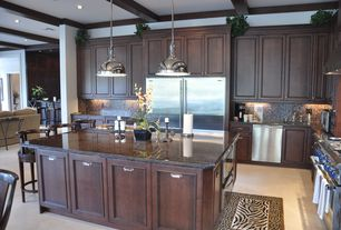 Traditional Kitchen with Kitchen island, Standard height, Crown molding, Raised panel, double oven range, Exposed beam