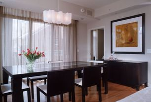 Contemporary Dining Room with can lights, Chandelier, Laminate floors, Standard height, specialty window, Built-in bookshelf