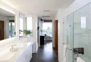 Contemporary Master Bathroom with Basalt Blue, frameless showerdoor, Flush, Master bathroom, European Cabinets, Limestone