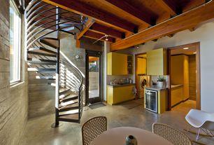 Modern Basement with Pangea Home Dana Rocking Chair, George Nelson Atomic Ball Wall Clock, Multi