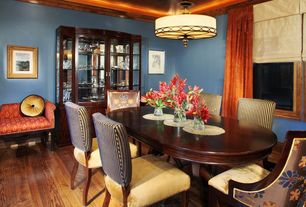 Traditional Dining Room with Hardwood floors, Standard height, flush light, picture window