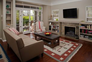 Eclectic Living Room with Standard height, stone fireplace, French doors, Hardwood floors, picture window, Transom window