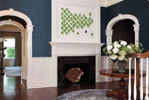 Contemporary Entryway with Cathedral ceiling, Wainscotting, Laminate floors, Fireplace, stone fireplace, Crown molding