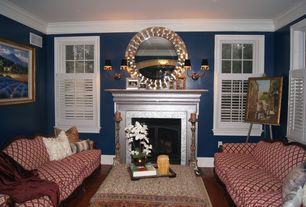 Traditional Living Room with Crown molding, Wall sconce, Laminate floors
