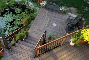 Contemporary Deck with Cardinal cast iron garden bench, Cable railing, Pond, Outdoor seating