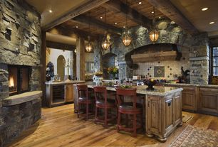 Rustic Kitchen with Large Ceramic Tile, Custom hood, L-shaped, Wine refrigerator, Framed Partial Panel, Exposed beam, Columns