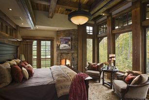 Rustic Master Bedroom with Box ceiling, stone fireplace, French doors, Carpet, Transom window, Natural wood framing