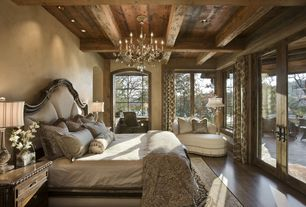 Traditional Master Bedroom with High ceiling, Exposed beam, Laminate floors, Chandelier, French doors, picture window