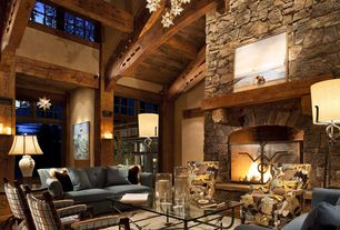 Rustic Living Room with Shades of light - superior moravian star light, Stacked stone fireplace, Exposed beam