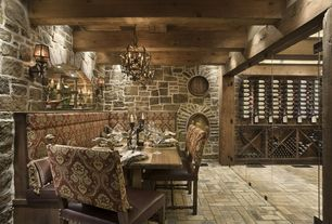 Rustic Wine Cellar with Exposed beam, Chandelier, Brick floors, Wall sconce, can lights, High ceiling