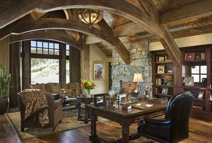 Rustic Home Office with flush light, stone fireplace, Built-in bookshelf, picture window, Standard height, Paint 1, Fireplace