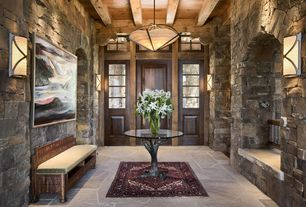 Rustic Entryway with Concord persian classics oriental medallion red area rug, Wall sconce, slate floors, Pendant light