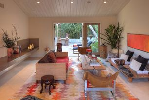 Contemporary Living Room with French doors, Concrete tile , can lights, Fireplace, Standard height, other fireplace