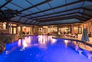 Mediterranean Swimming Pool with Outdoor kitchen, French doors, Covered pool, Swim up table, exterior stone floors