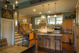 Country Kitchen with High ceiling, Crown molding, Hickory - brandywine 3 in. engineered hardwood plank, U-shaped, Custom hood