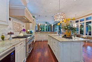 Traditional Kitchen with Decorative tile insert, Undermount sink, L-shaped, Hardwood floors, Ceiling fan, Crown molding