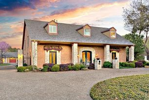 Cottage Exterior of Home with Exterior stone wall, Arched entrance