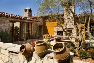 Mediterranean Patio with French doors, exterior stone floors, Restoration Hardware CARMEL COLLECTION, Fountain