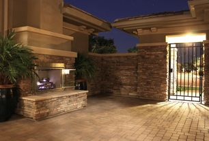 Country Patio with Concrete pavers, Outdoor fireplace, Stone wall tiles