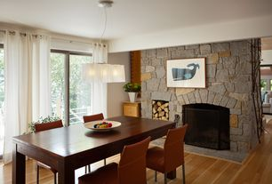 Contemporary Dining Room with Fireplace, Standard height, Laminate floors, sliding glass door, stone fireplace, Chandelier