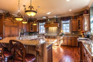 Traditional Kitchen with Standard height, Crown molding, Pendant light, Custom hood, Casement, Breakfast bar, Raised panel