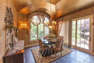 Traditional Dining Room with Chandelier, High ceiling, Casement, Wall sconce, simple granite floors, French doors