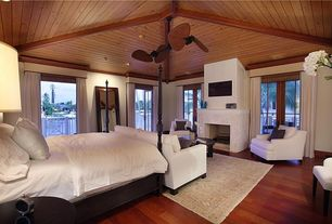 Tropical Master Bedroom with Wood ceiling, Hardwood floors, French doors, Ceiling fan, Crown molding, Exposed beam