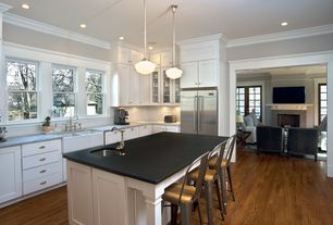 Cottage Kitchen with Flat panel cabinets, Breakfast bar, Simple granite counters, L-shaped, Kitchen island, Subway Tile