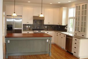 Traditional Kitchen with Flat panel cabinets, Glass panel, Stone Tile, Wood counters, Pendant light, L-shaped, Kitchen island